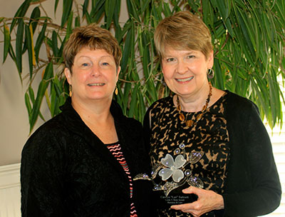 "Carolyn ""Lyn"" Turknett received the Linda T. Muir Award for Business and Law"